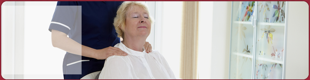 senior woman feeling relaxed with the caregiver's massage